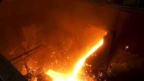 Close up for molten metal poured from ladle for casting at the foundry. Stock footage. Smelting of metal casting stock video