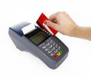 Close-up of moment of payment by credit card. Isolated on white background Royalty Free Stock Image