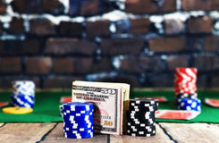 Close up of money between casino chips Stock Images