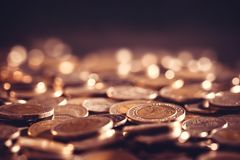 Close up money coin on the floor in dark light , business and fi Stock Photos