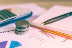 Close up money coins stack. Concept business finance , Close up Coin and pen on summary report and calculator on table Stock Images