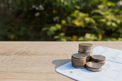 Close up money coins stack. In saving money and growing on book bank, concept save money financial Royalty Free Stock Image