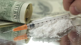 Close Up Money, Drugs, Heroin, dollars, syringe.