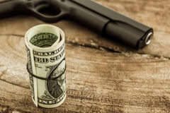 Close up money with Gun . Royalty Free Stock Photography