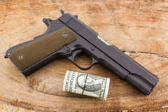 Close up money with Gun. Royalty Free Stock Image
