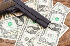 Close up money with gun. Stock Photography