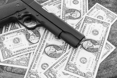 Close up money with gun. Stock Images
