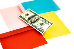 Close up of money in pink envelope are lying on the Multi colored envelopes and letters as a background.  Branding mock up; differ stock images