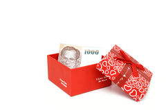 Close up money in red Gift box isolated on white background Royalty Free Stock Photography