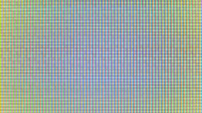Close-up of the monitor`s pixels. RGB pixels on the TV during the screening of the film, macro, close-up. Red, blue and green sub pixels create an image on the stock video
