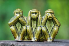 Close up Monkey statues made of ceramic in concept of see no evil, hear no evil and speak no evil.  royalty free stock images