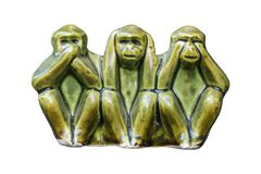 Close up Monkey statues made of ceramic in concept of see no evil, hear no evil and speak no evil.on white background.  stock photography
