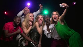 Close-up of mono-ethnic friends make selfie and dancing. Slow motion. Close-up of mono-ethnic friends make selfie and dancing in the club against background stock footage