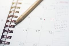 Close up monthly planner and pencil. Planning for business meeting or travel planning concept royalty free stock image