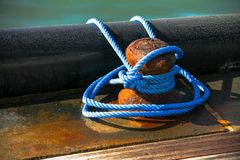 Close-up of mooring bollard with blue rope Royalty Free Stock Image