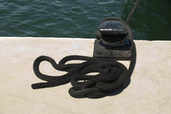 Close-up of mooring bollard in marina Stock Images