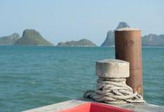 Close-up of mooring bollard with rope in marina. Thailand Royalty Free Stock Photos