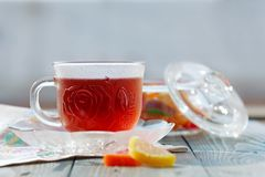 Close up of a morning black tea and colorful marmalades in glass jar on wooden table stock images