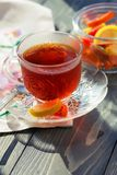 Close up of a morning black tea and colorful marmalades in glass jar on wooden table stock photography