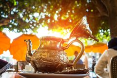 Close up of a moroccan tea pot. Against sun light Royalty Free Stock Photography