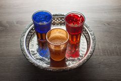 Moroccan traditional tea. Close up of moroccan traditional tea glasses on a silver plate Stock Photos