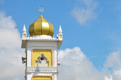 Close up of mosque tower with golden dome Stock Photo