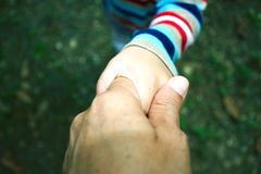 Mother check hand with young girl hand stock photos