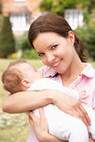 Close Up Of Mother Cuddling Newborn Baby Boy Outdo Stock Photography