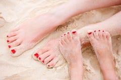 Feet on tropical sand Stock Photo