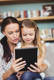 Close-up of mother and daughter looking in digital tablet Royalty Free Stock Photo