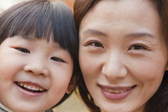Close-up of Mother and Daughter smiling in the park, autumn, Portrait Stock Photos