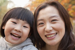 Close-up of Mother and Daughter smiling in the park, autumn, Portrait Royalty Free Stock Photography