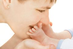 Close up of mother kissing baby's feet Stock Photos