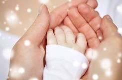 Close up of mother and newborn baby hands Royalty Free Stock Images