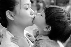 Closeup mother and son kissing together : black and white. Close up mother and son kissing together : black and white royalty free stock photography