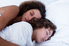 Close-up of mother and son sleeping together Stock Images