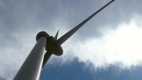 Close up motion of a windmill against a blue sky, wind power technology. View on turbine. Cyprus. stock video footage