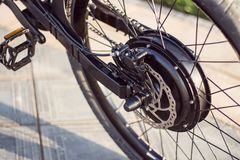 Close up of motor electric bike. Ebike bicycle environmentally friendly eco e-mountainbike transport. Healthy lifestyle Stock Photography