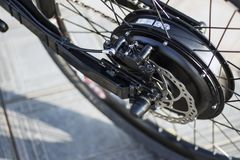 Close up of motor electric bike ebike bicycle. Close up of motor electric bike. Ebike bicycle environmentally friendly eco e-mountainbike transport. Healthy stock photography