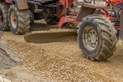 Close up of motor grader working on gravel leveling 2 Royalty Free Stock Photo