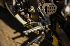 Close up motorcycle foot peg and shifter.  stock photos