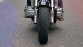 Close up of a motorcycle front wheel turning. stock video footage