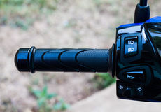 Close up of motorcycle handle, shallow dof, focus on buttons.  royalty free stock photo