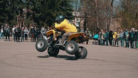 Close-up of a motorcyclist on an ATV. He makes a sharp turn in front of the crowd at the motor show. stock footage