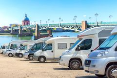 Close up motorhomes parked in a row on background The Saint-Pierre bridge passes over the Garonne river in Toulouse. France Royalty Free Stock Photography