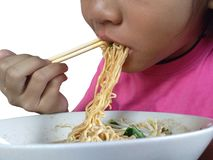 Close up mouth Asian child girl eating noodles. stock photo