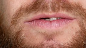 Close-up of the mouth. A man shows his denture stock footage