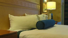 Close up Move across Hotel Bed. A close up view moving across a clean hotel room bed stock footage