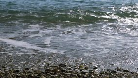 Close up of movement of sea water surf over beach stock footage