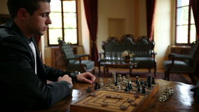 Close up of moving chess figures by two business men stock video